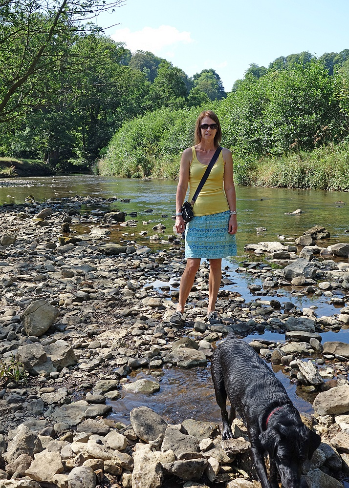 Tracey at a river with Poppy - Poppy likes water !